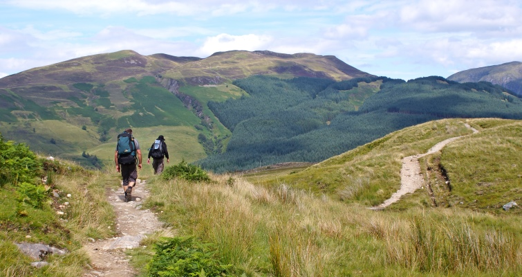 Hikers make their way along the West Highland Way.